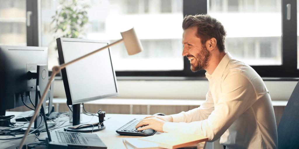 happy man working at desk